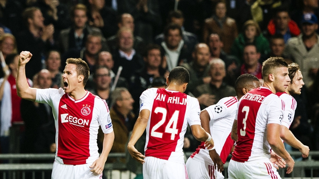 Ajax's Niklas Moisander punches the air after scoring his side's second goal against Manchester City