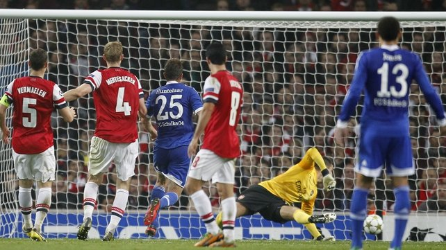 Klaas-Jan Huntelaar (No 25) opened the scoring for the visitors in north London