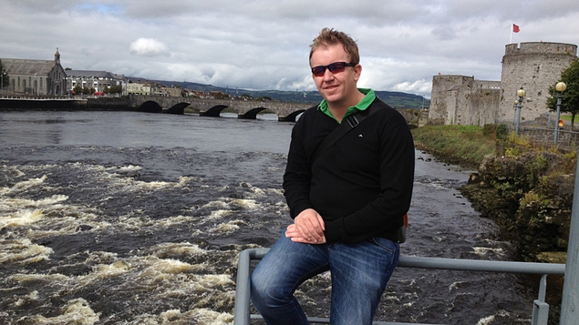Ed Leahy, sitting by the Broad Majestic Shannon with King John's Castle in background