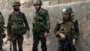 Syrian soldiers are trying to push rebels from key positions in Damascus