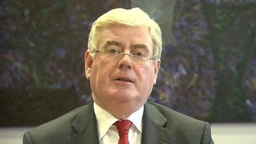 Eamon Gilmore said the targets set and agreed had been expressed in percentage terms
