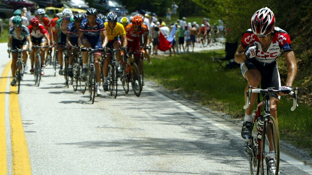 Bobby Julich breaking clear of Lance Armstrong and the peloton back in 2004