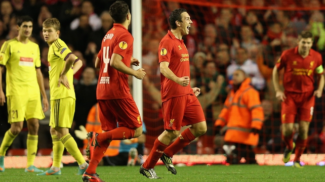 Liverpool's Stewart Downing celebrates his sublime strike at Anfield