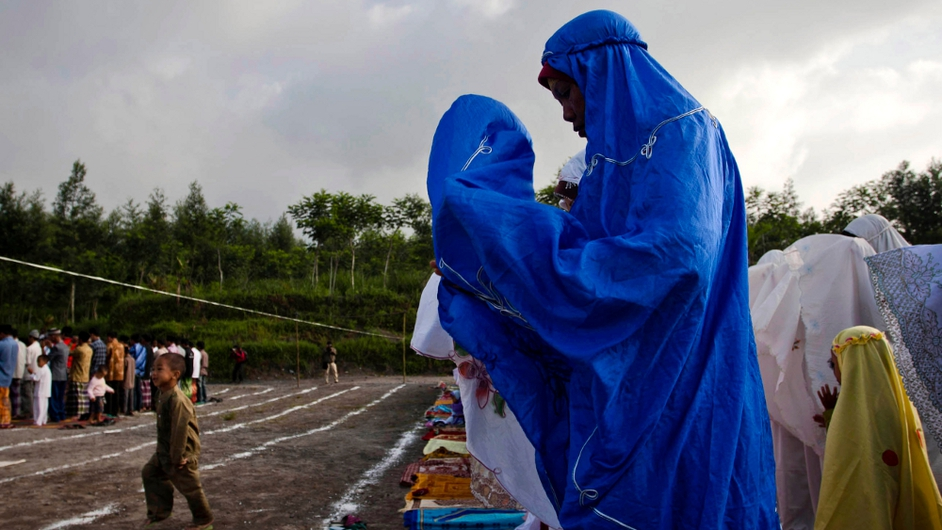 Indonesian Muslims attend prayer at the slopes of Mount Merapi during celebrations for Eid al-Adha, the 'Festival of Sacrifice'