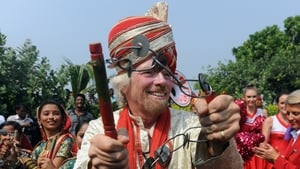 British business tycoon Richard Branson performs a traditional Lezim dance in Mumbai