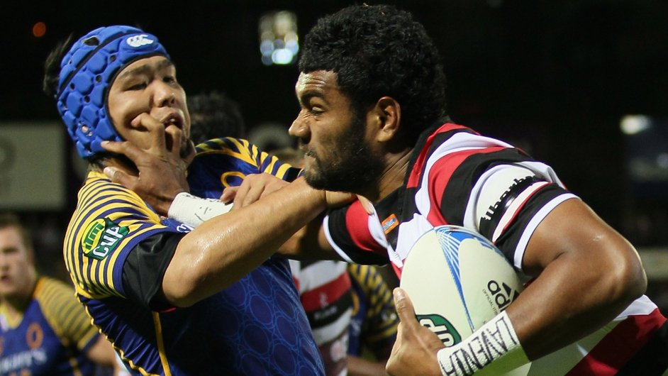 Sikeli Nabou of Counties Manukau fends off Shota Horie of Otago during the ITM Cup Championship Final in New Zealand