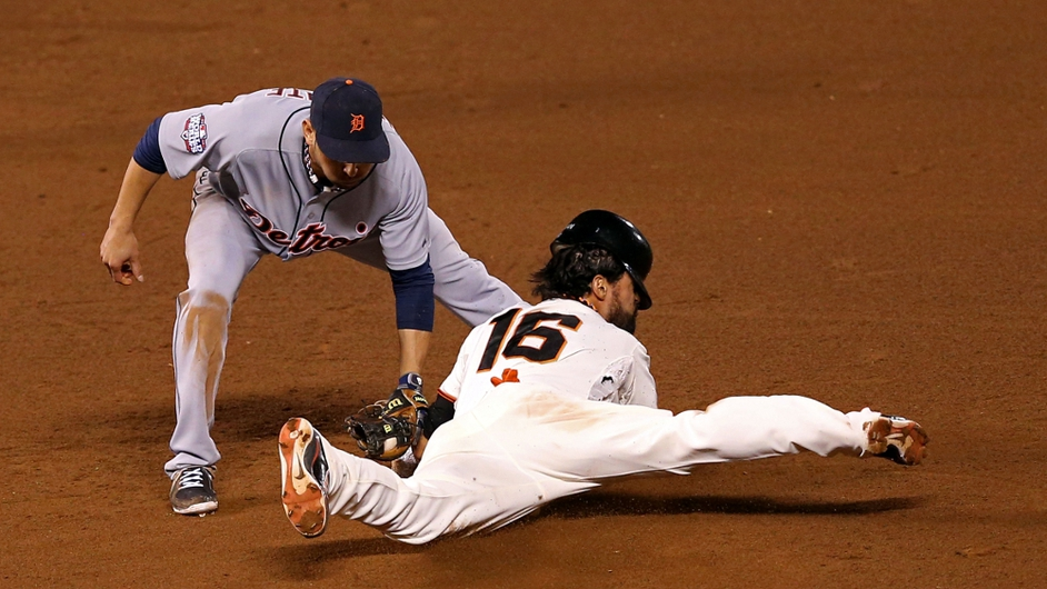 Angel Pagan of the San Francisco Giants successfully steals second base ahead of the tag attempt by Omar Infante of the Detroit Tigers in the eighth inning