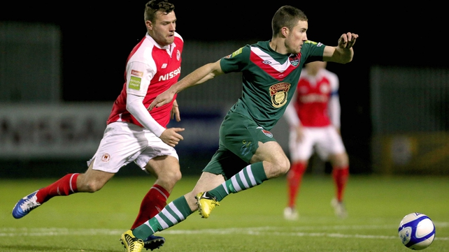 St Patrick's Athletic's James Chambers closes down Cork City's Gearoid Morrissey