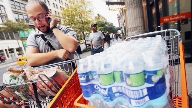 New Yorkers are stocking up on essential supplies as the storm approaches