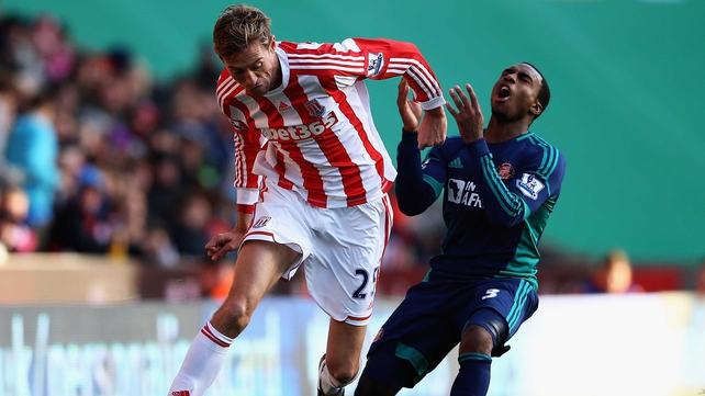 Stoke's Peter Crouch holds off Sunderland's Danny Rose at the Britannia Stadium