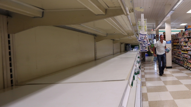 Many shops are running low on basic supplies, such as bread and water