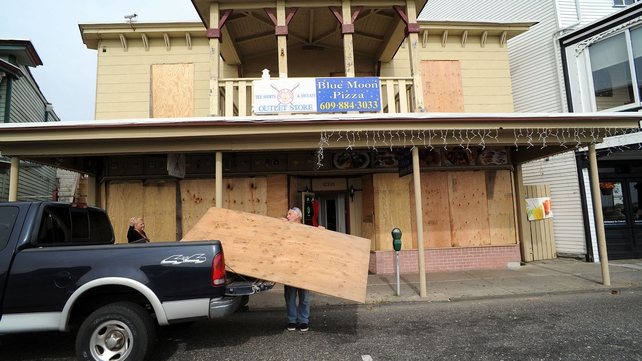 New Jersey shopfronts have been boarded up as Hurricane Sandy approaches
