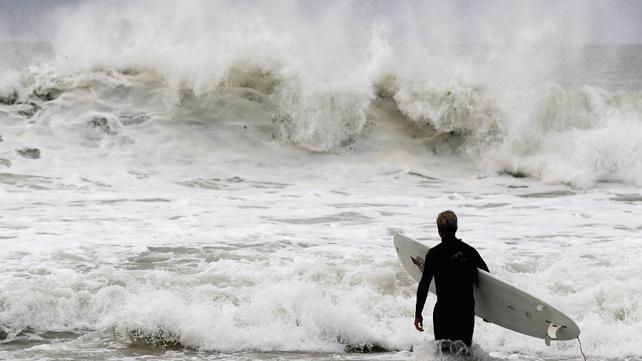 A man surfs as Hurricane Sandy approaches in Long Beach, New York