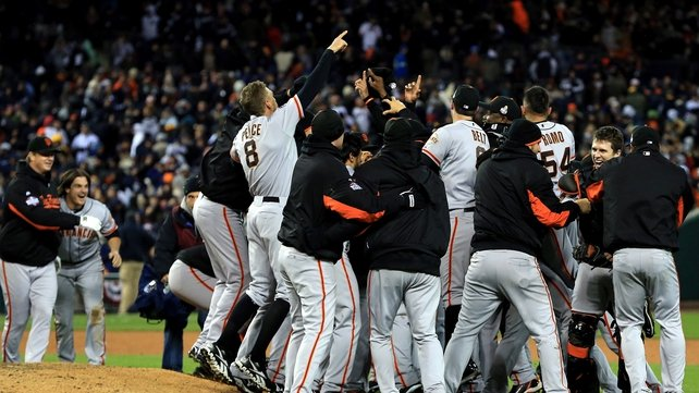 San Francisco players celebrate in the tenth inning after clinching the all important win