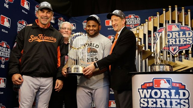 The World Series trophy is handed over