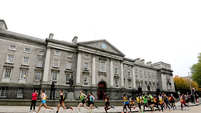 The elite runners go past Trinity College in conditions that were ideal throughout