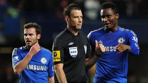 John Obi Mikel has a word with Clattenburg as Juan Mata looks on during the clash with Manchester United