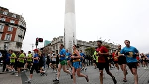 Runners on O'Connell Street with the Spire in the background