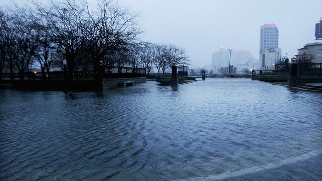 Flood waters begin to flood a street near the ocean in Atlantic City, New Jersey