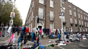 Discarded clothes litter the streets after the Dublin Marathon