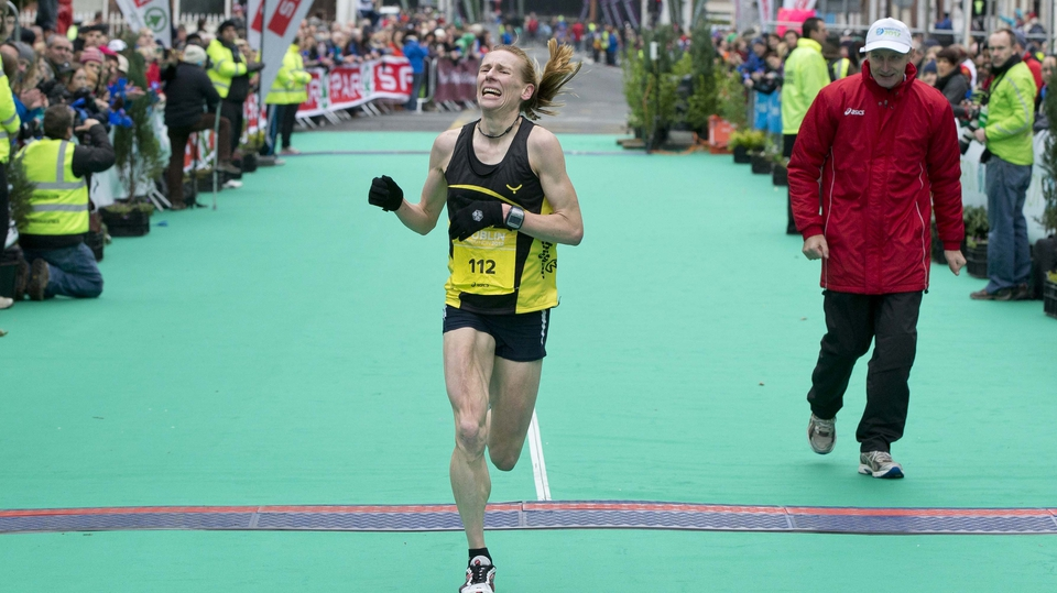 The strain on Maria McCambridge's face was clearly evident as she crossed the finishing line