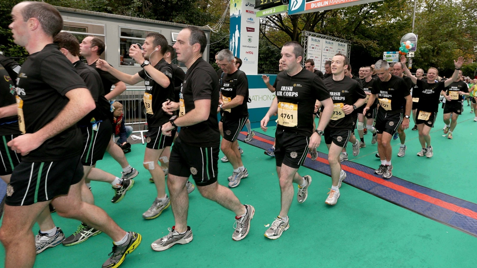 Members of the Irish Air Corps cross the finishing line in formation