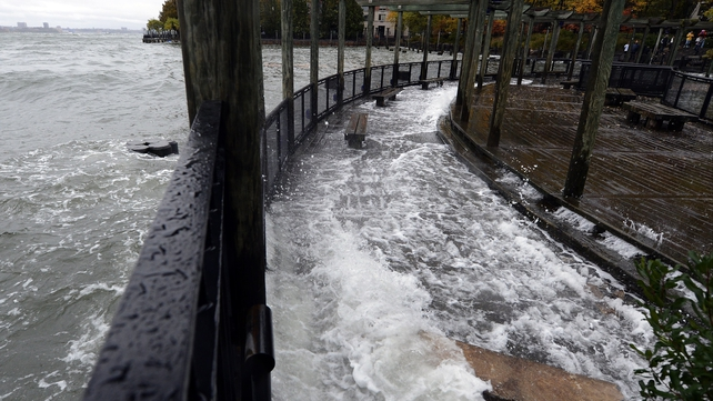 The Hudson River comes over the sea wall along the West Side Promenade in the Battery Park area in New York