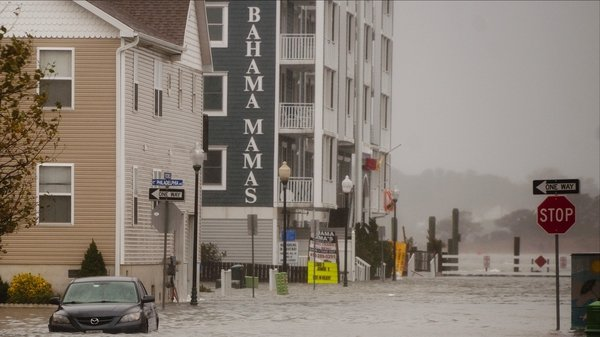 A car sits in a flooded street of Ocean City in Maryland