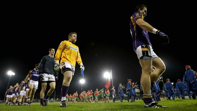 Kilmacud Crokes' Adrian Morrissey leads his team during the pre-match parade