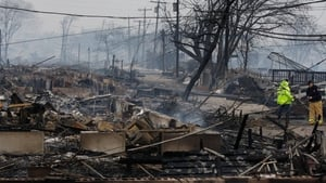 Several homes were destroyed by fire after being flooded at Breezy Point in the borough of Queens