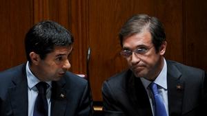 Portuguese Prime Minister Pedro Passos Coelho (R) said Portugal needed to 'turn the page'