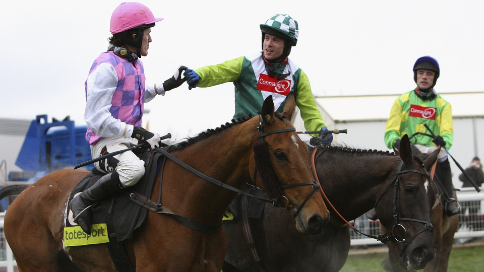 Sam Thomas on Denman (centre) is congratulated by Tony McCoy on Exotic Dancer (left) as Ruby Walsh on Kauto Star (right) look on after Denman's victory in the 2008 Gold Cup