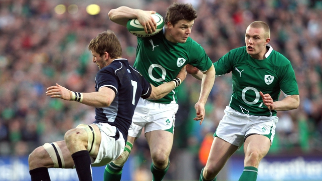 Brian O'Driscoll, supported Keith Earls, evades Scotland's John Barclay