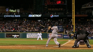 Marco Scutaro of the San Francisco Giants hits the RBI single that wins the World Series in the 10th inning of Game 4 against Detroit