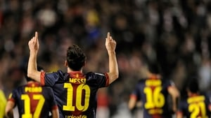 Lionel Messi of Barcelona celebrates scoring his side's fifth goal against Rayo Vallecano