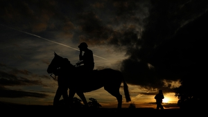 A jockey pulls his goggles down as he makes his way to the start at Taunton Racecourse