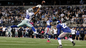 Miles Austin of the Dallas Cowboys reaches for what would have been a game-ending pass against the New York Giants