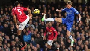 A high challenge between Manchester United's Rio Ferdinand and Chelsea's Fernando Torres at Stamford Bridge