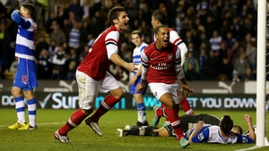 Theo Walcott celebrates scoring Arsenal's sixth goal against Reading in the English League Cup