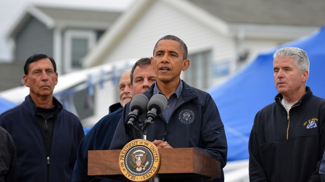 US President Barack Obama speaks after visiting an affected neighbourhood in Brigantine, New Jersey