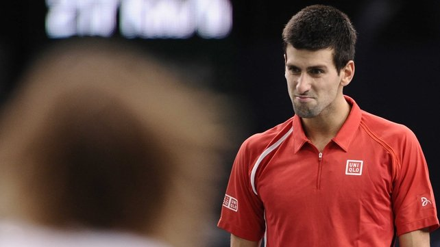 Novak Djokovic won the opening set to love but then lost the next two sets to crash out in Paris