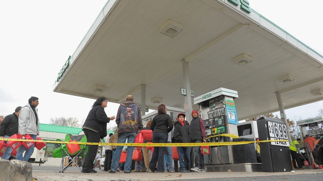 New Jersey residents queue for fuel at one of the few petrol stations that has remained open
