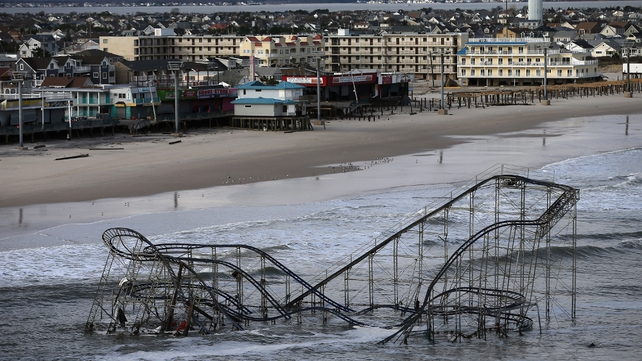 Waves hit the wrecked roller-coaster in Seaside Heights, New Jersey