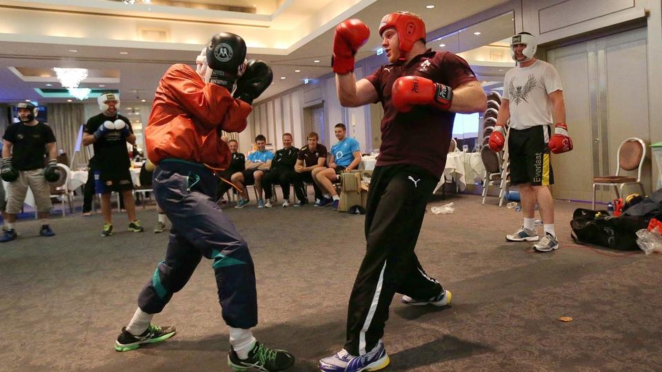Michael Conlan fends off Ireland hooker Sean Cronin