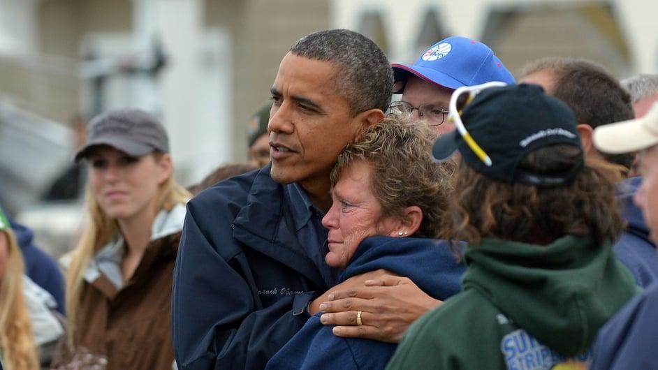 US President Barack Obama comforts Hurricane Sandy victim Dana Vanzant as he visits a neighbourhood in Brigantine, New Jersey