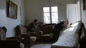 Rebel fighters take position in a flat in Aleppo during a battle against Syrian government forces