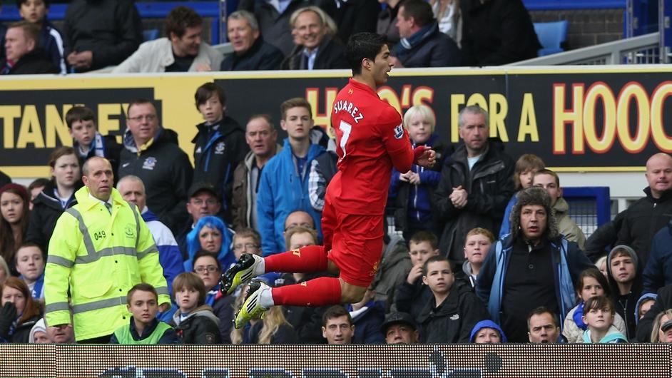 Liverpool striker Luis Suarez celebrates scoring the opening goal during the Barclays Premier League match against Everton at Goodison Park
