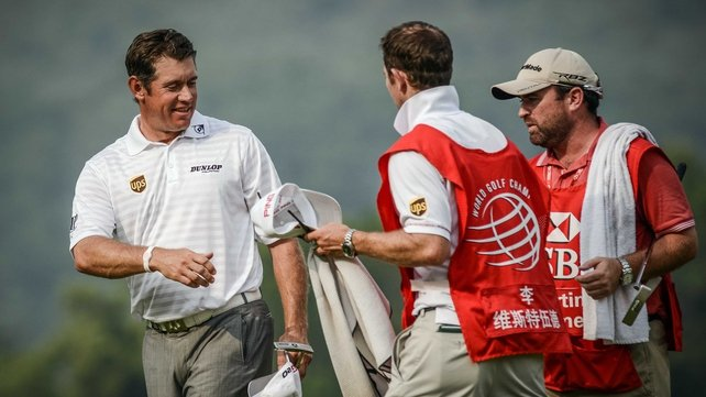 Lee Westwood shakes hands with caddies after completing the third round