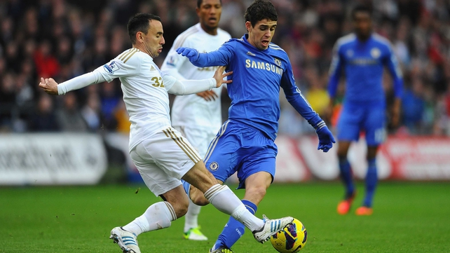 Oscar of Chelsea battles with Swansea's Leon Britton