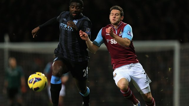 Manester City's Kolo Toure (l) and Matt Jarvis of West Ham battle for the ball